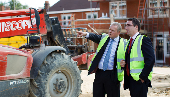 Annual Report Photograph of Management at Residential Housing Development, Surrey