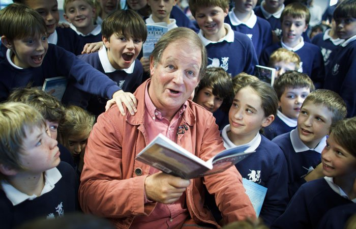 Photograph of Michael Morpurgo reading to the children at the Unicorn School, Abingdon
