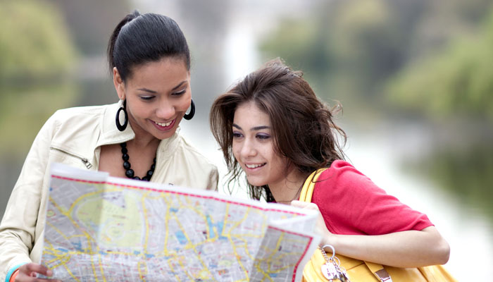 Photograph of London Business School Student Reading a Map