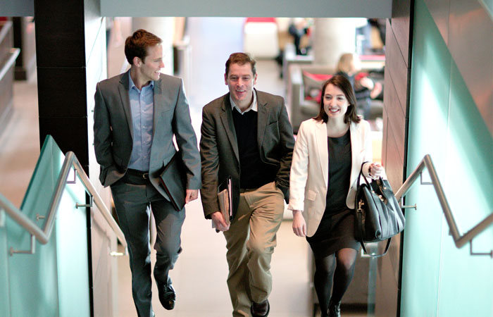 Photograph of Business Individuals Walking in London Office
