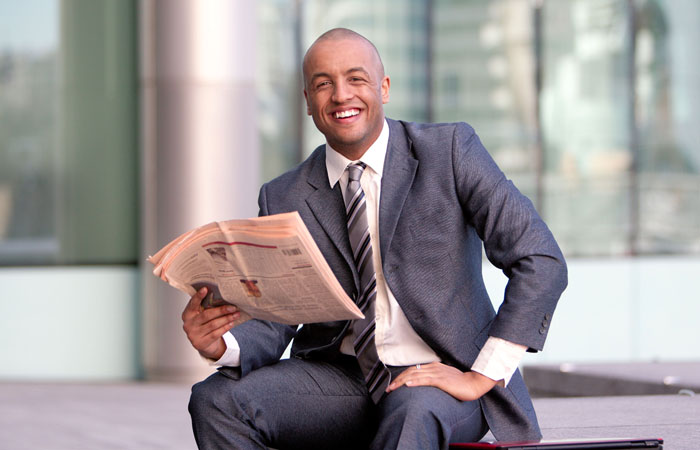 Photograph of London Business and Finance Student reading Financial Times