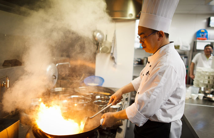 Chinese Kitchen Staff Photographed at Event in Grosvenor Hotel, London
