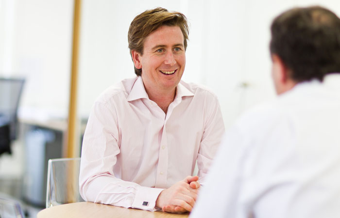 Working Photograph of Director in Meeting