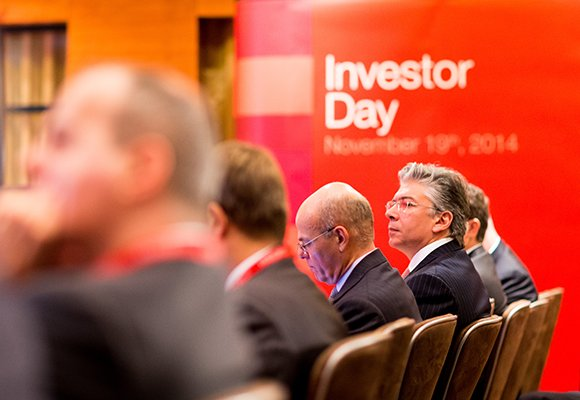 Investors listening to speaker in London at event