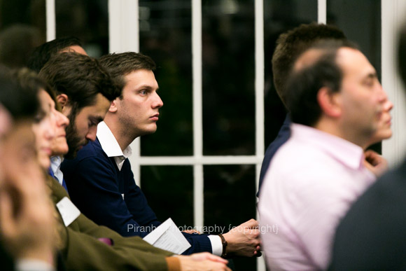 Guests listening at evening event