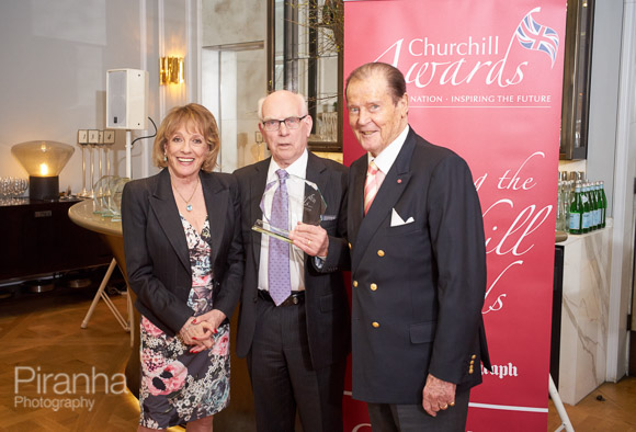 Esther Rantzen and Sir Roger Moore presenting awards