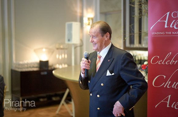 Sir Roger Moore making speach at awards ceremony