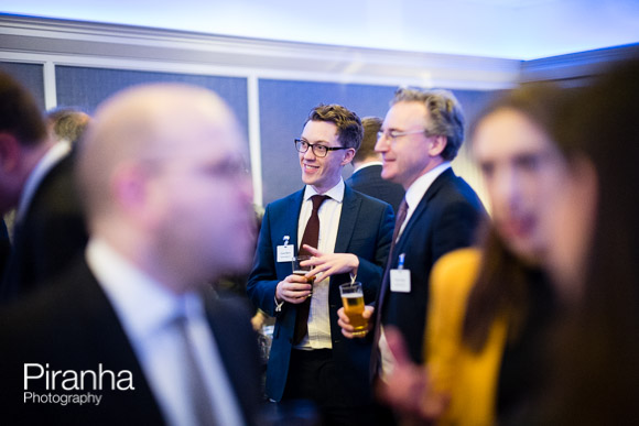 Individuals chatting at drinks reception in London