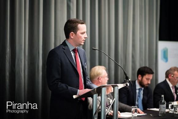 Speaker at podium during London event