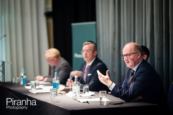 Speakers talking to audience during London event