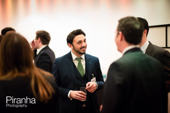 Guests mingling at drinks reception of corporate event in London