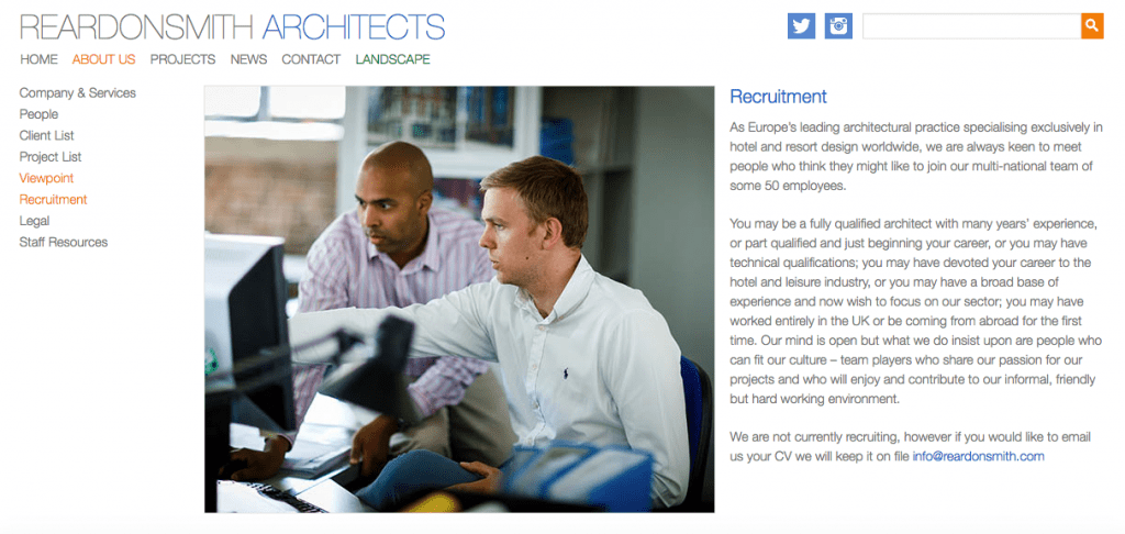 Architects Website Photograph of two people discussing a project