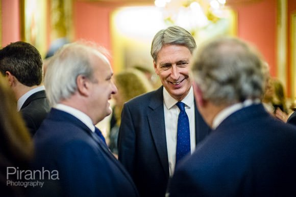 Philip Hammond with guests at evening event at In & Out Club