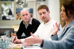 Reportage business meeting photography of individuals in conversation