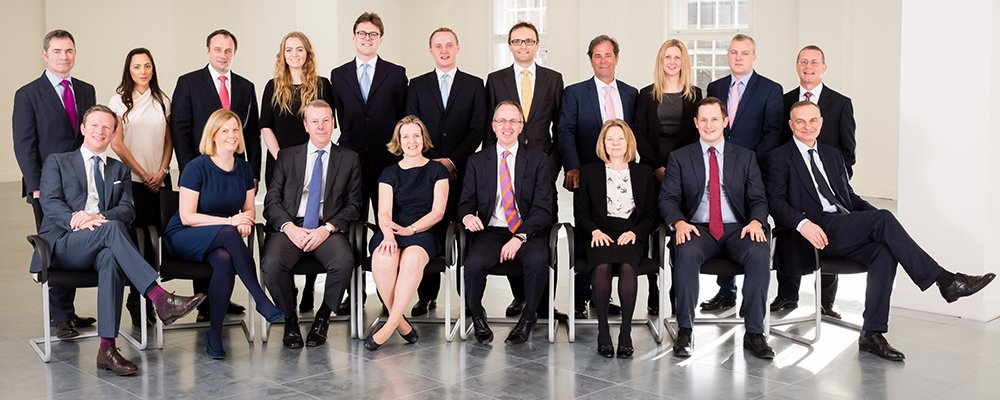 Shot of chartered surveyors team all together in London offices