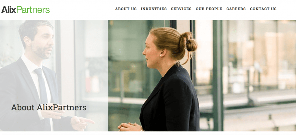 Corporate photograph of 2 people in conversation on client website