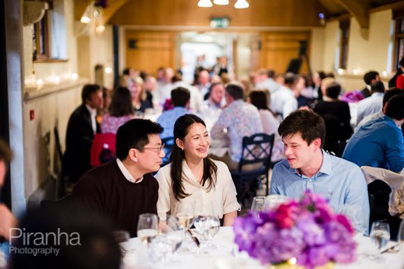 Guests seated at dinner photographed during summer party