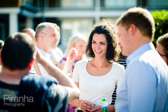 Guests mingling during event in Fulham studios
