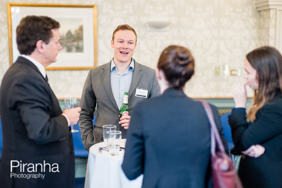 Guests discussing at law event in London photographed by Piranha