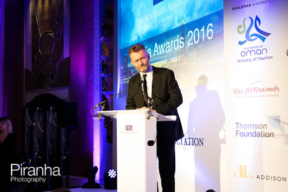 Hugh Dennis speaking at Awards in London