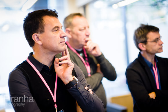 Employees listening to conference speaker presenting