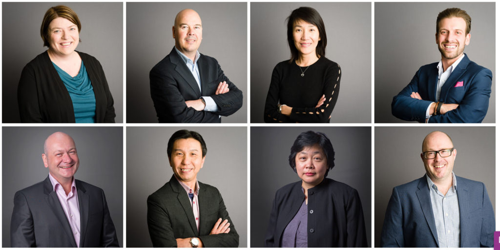 Headshots of employees on grey background