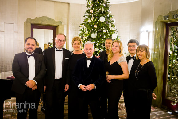 Group photograph with Christmas tree at Hotel in London