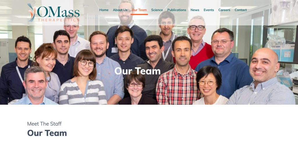 Oxford team photograph of all staff members together in laboratory - appearing at top of web page
