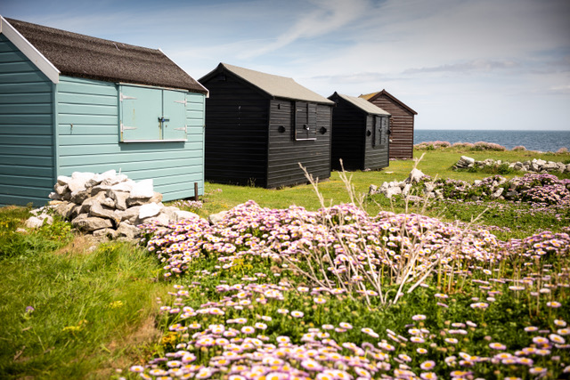 Photograph of a number of beach huts on Portland in Dorset