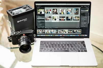 MacBookPro tethered to Leica camera for fast turnaround of headshot photographer London photography