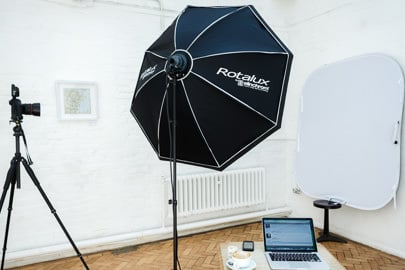 Heashot photographer London studio setup in client office with portable backdrop and lighting